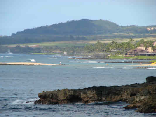 The living room offers direct views of the Poipu surf and much of the South Shore.